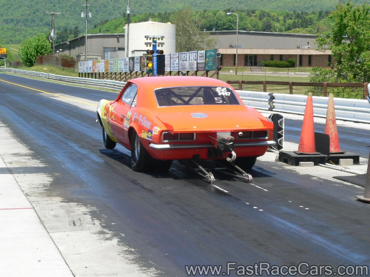 Orange Camaro On The Wheelie Bars