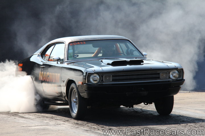 Black Dodge Dart doing Burnout