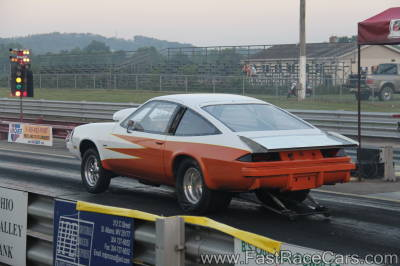 Yellow and Orange Monza Drag Car