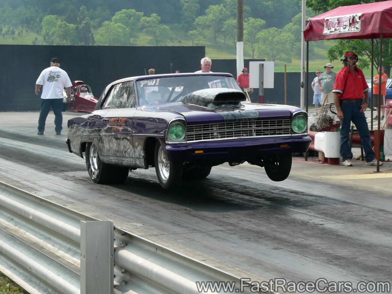 Purple Nova Drag Car Popping Wheelie