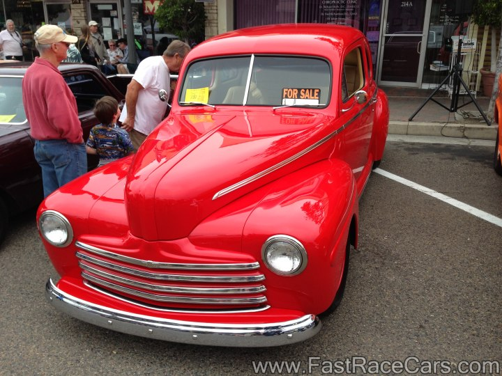 Red 1940s Ford Deluxe Coupe