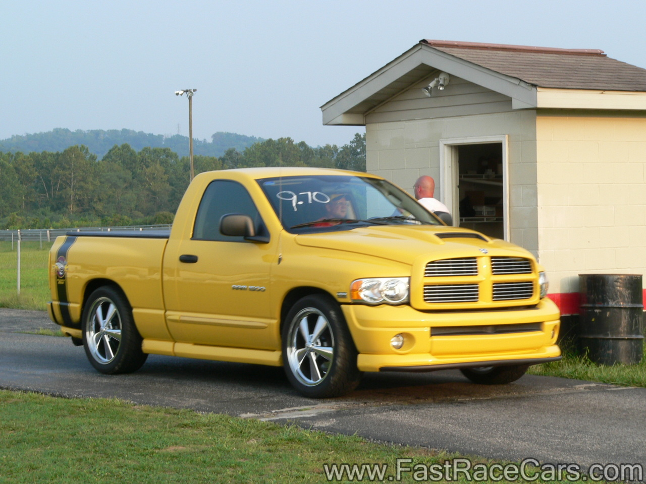 Yellow dodge ram truck with rumble bee package